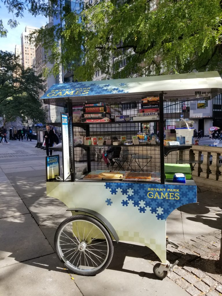 Bryant Park Board Games cart outside New York City Public Librrary