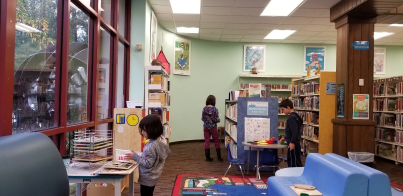 Three children play in the junior section of the Slidell Public Library in Louisiana.