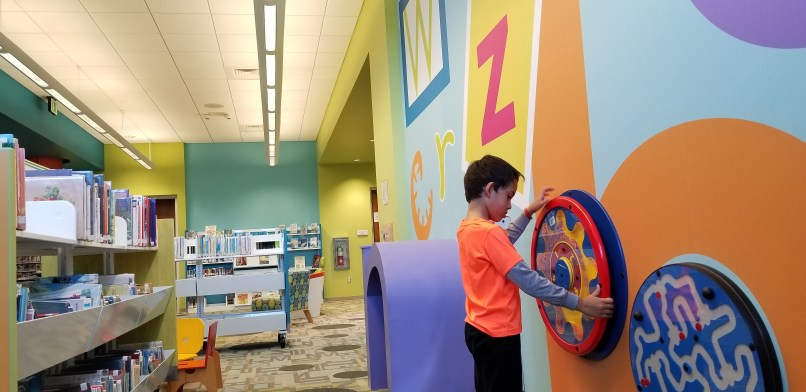 A boy plays at the children's section of the Breaux Bridge Library