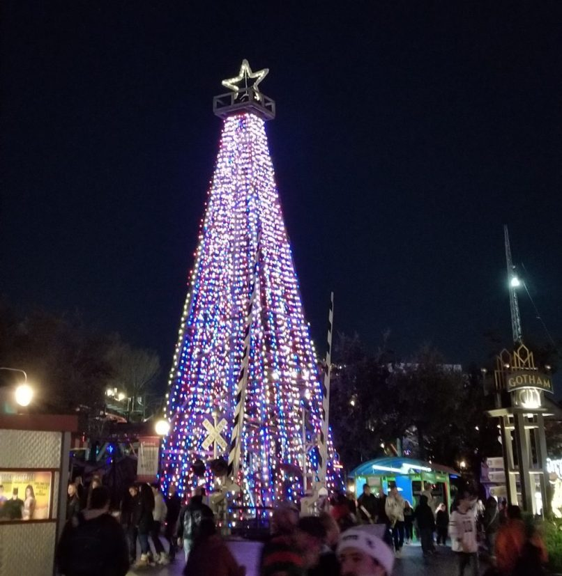 Six Flags Over Texas tower decorated for Christmas with Christmas lights and a star.