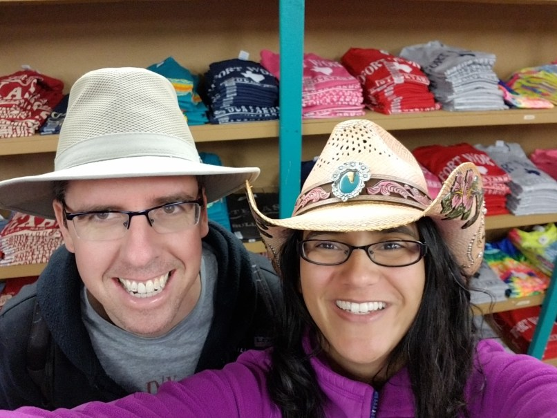 Men and woman take a selfie wearing hats in Fort Worth, Texas