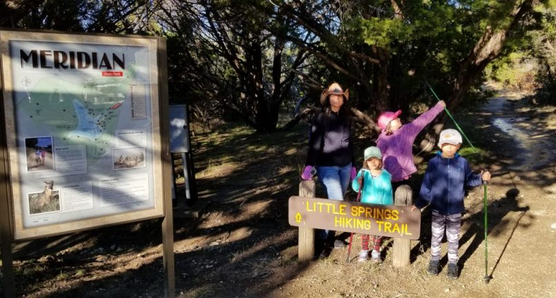 Mother with her son and two daughters at Meridian State Park Litte Creeks Trailhead