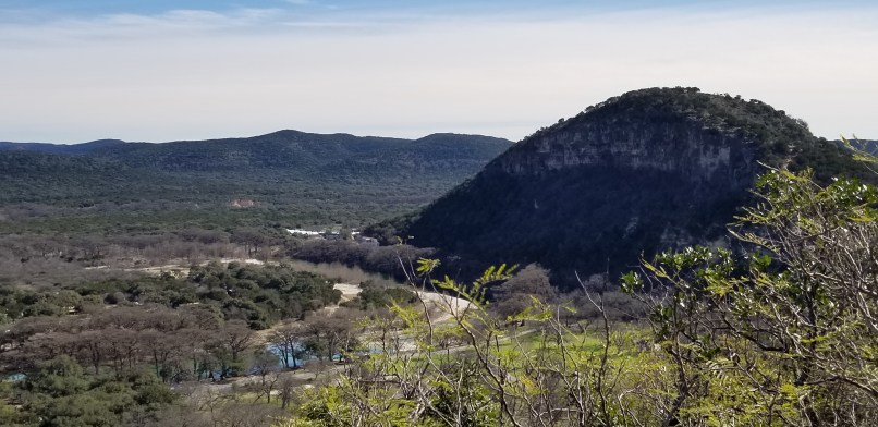 View from Bridges Trail, Garner State Park. A mountain and the Frio River can be seen. Photo by Mariana Abeid-McDougall on www.marianamcdougall.com