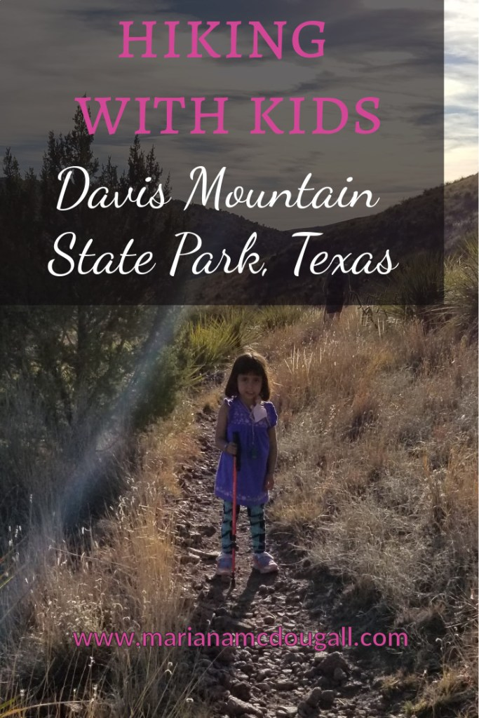 Pinterest Title Image. White and pink text reads: Hiking with Kids, Davis Mountain State Park, Texas, www.marianamcdougall.com. Background photo by Mariana Abeid-McDougall. a 4-year-old girl standings on a trail. She is holding a walking stick.