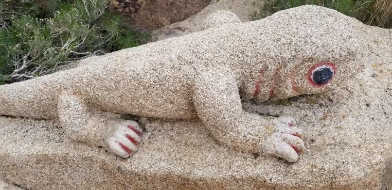 lizard stone sculpture at boulder park, Jacumba, California