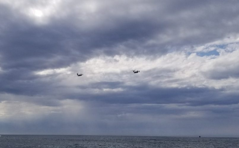 Two navy airplanes flying above the ocean in La Jolla Cove
