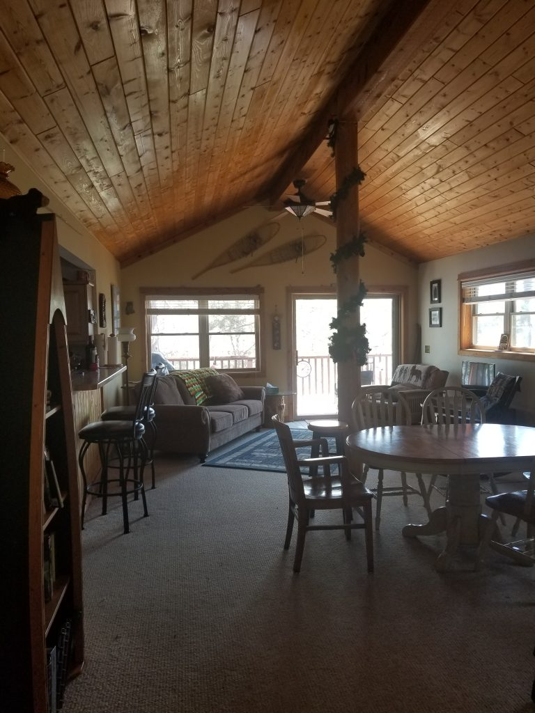 Living room and dining room of a cabin in Pequot Lakes, Minnesota.