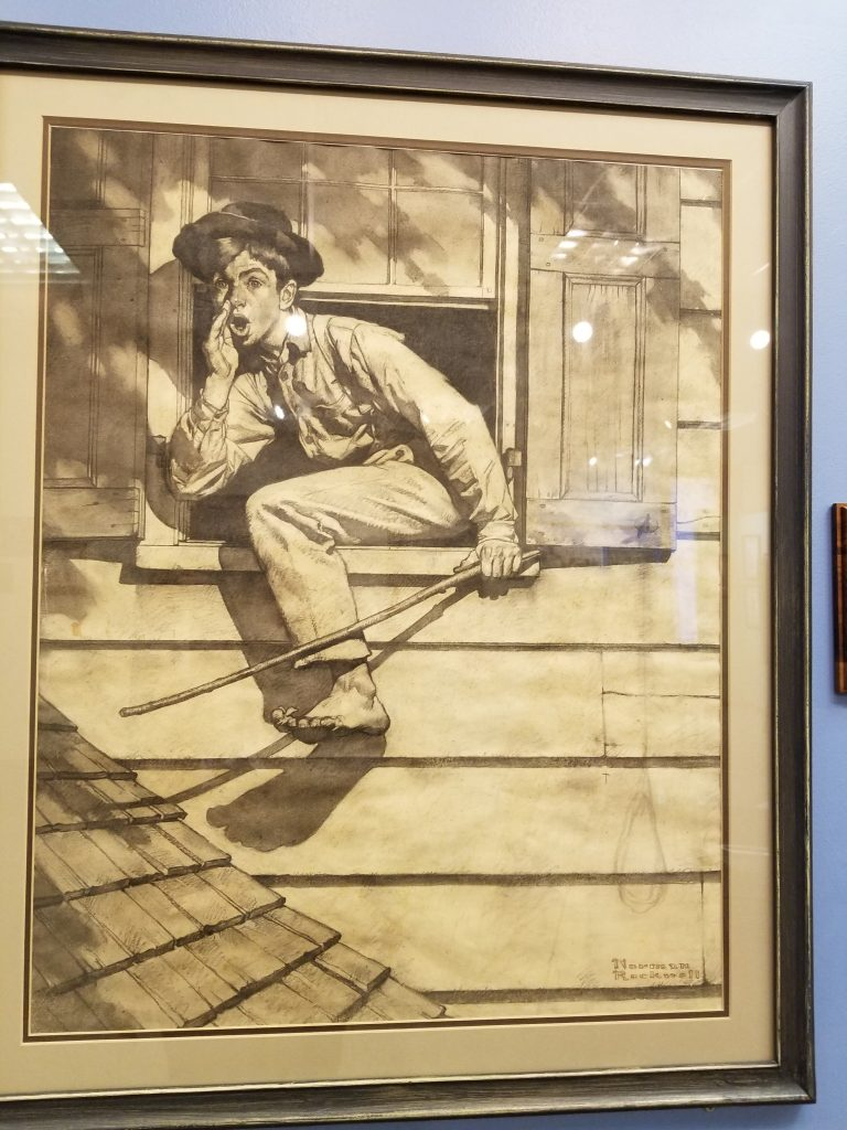 Normal Rockwell drawing of Tom Sawyer, on display at Mark Twain Museum
