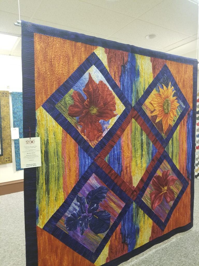 A watercolour flowers quilt presented at the Hannibal Bicentennial Quilt Exhibtion