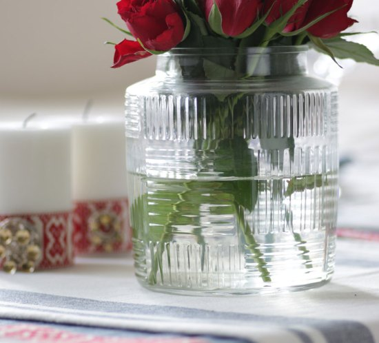 Table setting with red roses