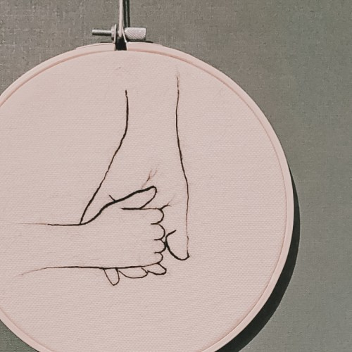 Felted hands in embroidery hoop