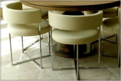 Designer Furniture : Porada Anxi chairs in cream leather at Marie Charnley Interiors