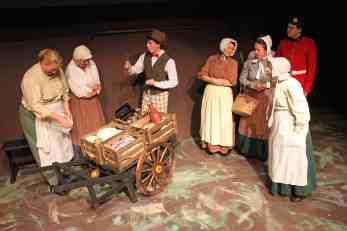 Photo of the scene when The Cheapjack comes to Lark Rise, Sewell Barn Theatre in Norwich