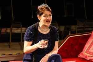 Photo of Marie Cooper actor as Anna Mary complaining about the dinner party onstage during Come into the Garden, Maud