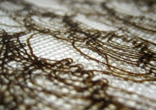 Lace knitted and siliconed textile.