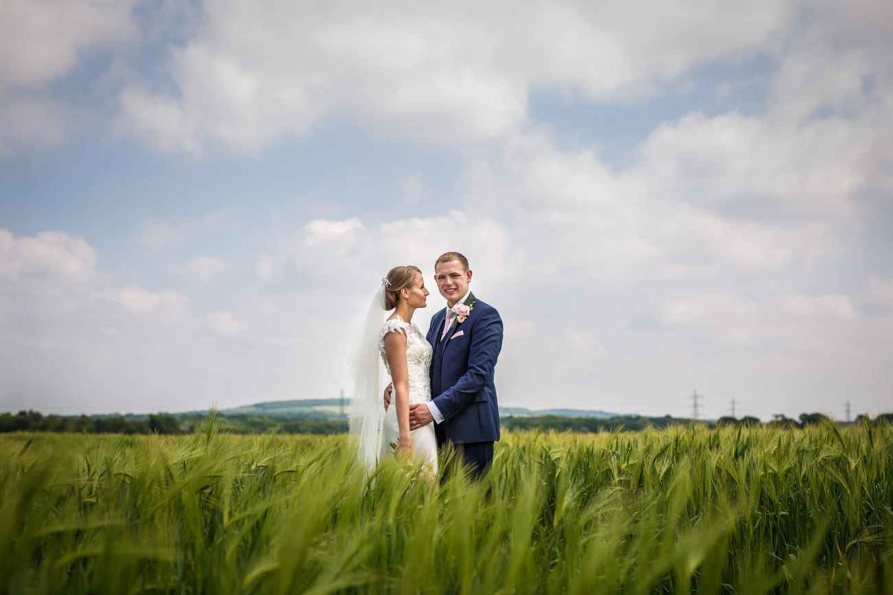 bride looking at groom in field