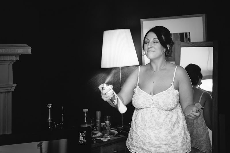 black and white wedding photography of bride getting ready in Ruthin, North Wales