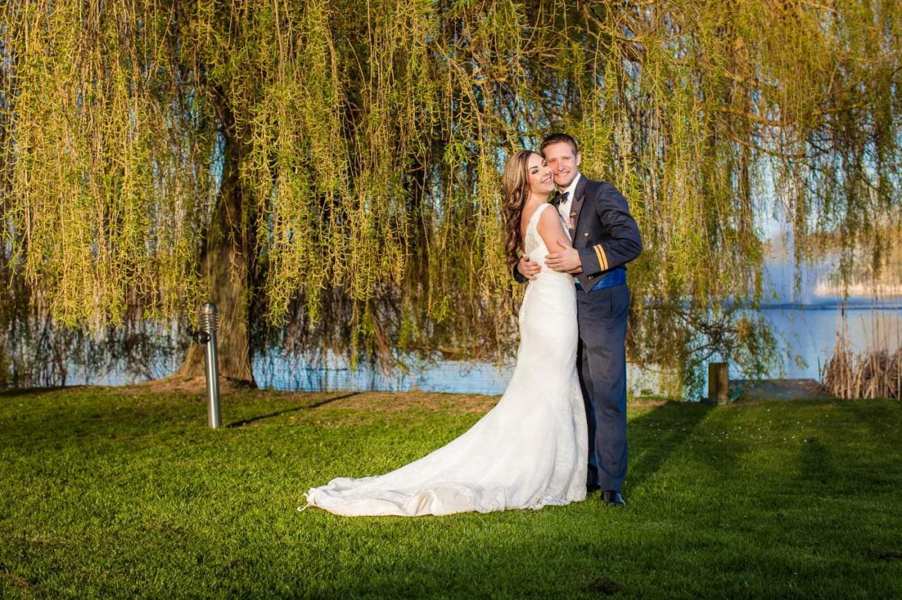 Weding Photography of couple by lake at Netley Hall,  Shropshire