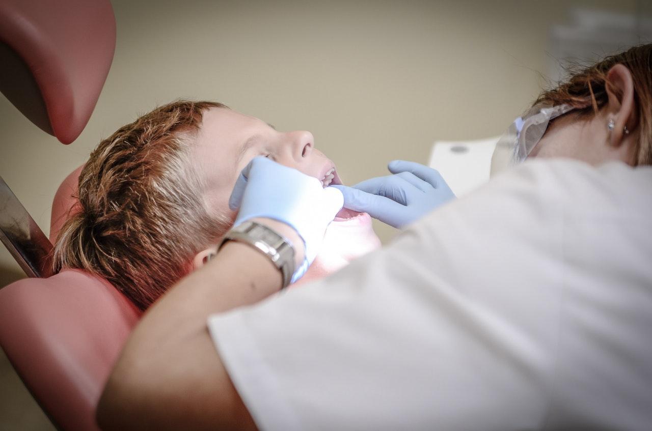 a boy doing dental checkup