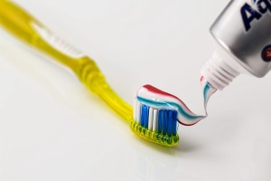 a yellow toothbrush and a colorful toothpaste