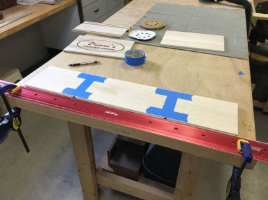 Using painters tape hinges for aligning and folding mitered box corners.