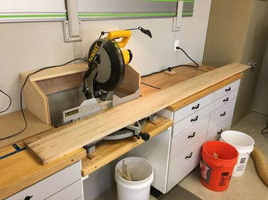 Cutting top boards to length with a couple of inches extra.