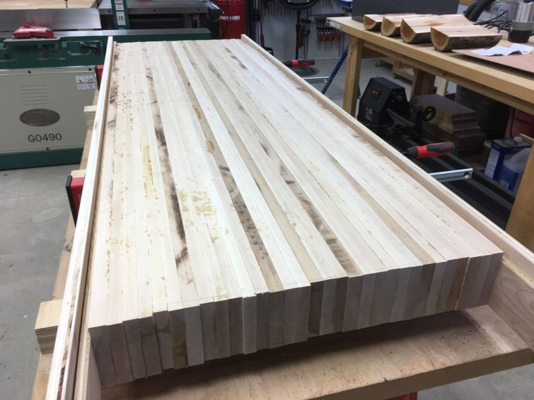 Positioning plywood rails for flattening