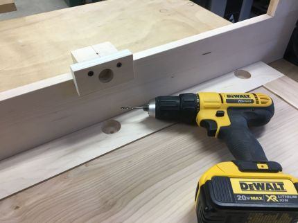 Shop made jig for drilling pilot holes in face frames for cup hinges