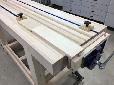 Oak dowel dogs line up with T-tracks