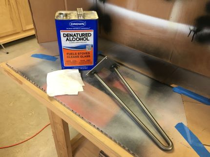Wiping the raw steel hairpin legs with denatured alcohol