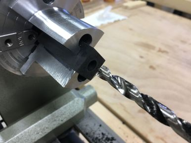 An 8mm brad point bit in the drill chuck mounted in the tailstock