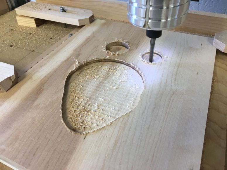 Cutting two circular pockets in the front of the back blank, for chain and other storage