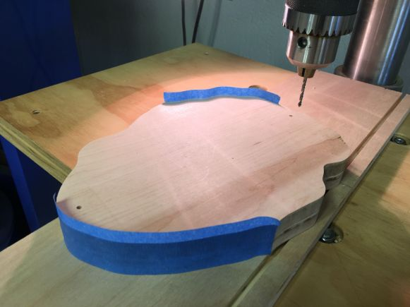 Pad drilling alignment holes in back and front pieces