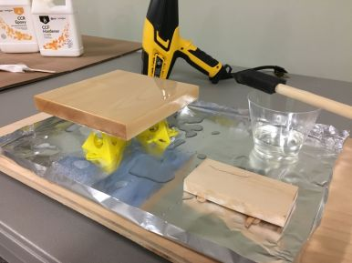 The heat gun was ready to help eliminate any bubbles in the epoxy, but was not needed on this pour