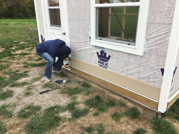 Linda Attaches the First Piece of LP SmartSide Siding