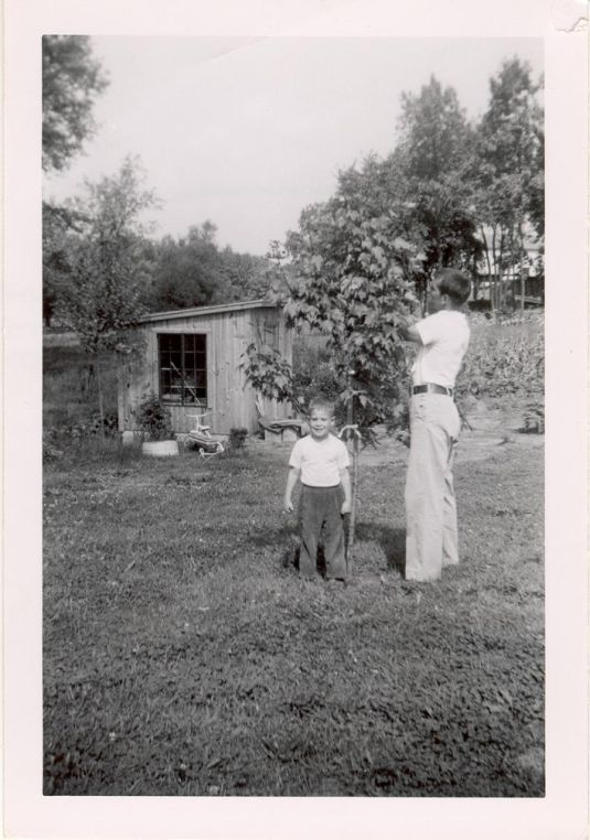 Pop and John with The Cottage and Garden Beyond