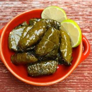 Dolmades - delicious stuffed grape leaves with rice and herbs | www.marilenaskitchen.com
