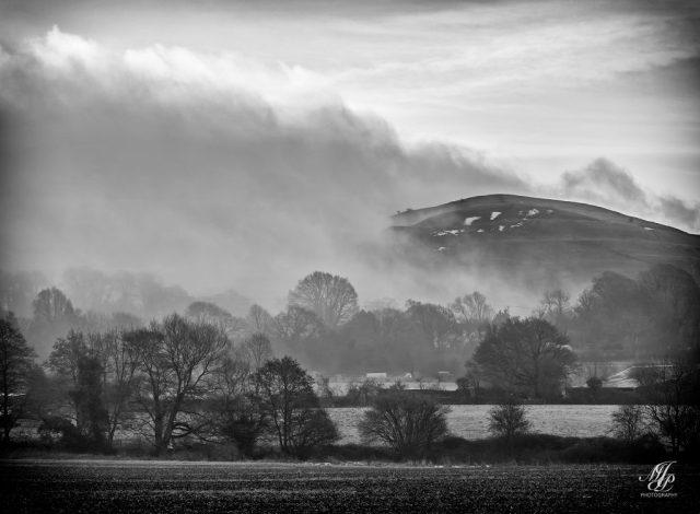Mist rising over Hambledon Hill