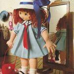 Muñeca de tela colegiala