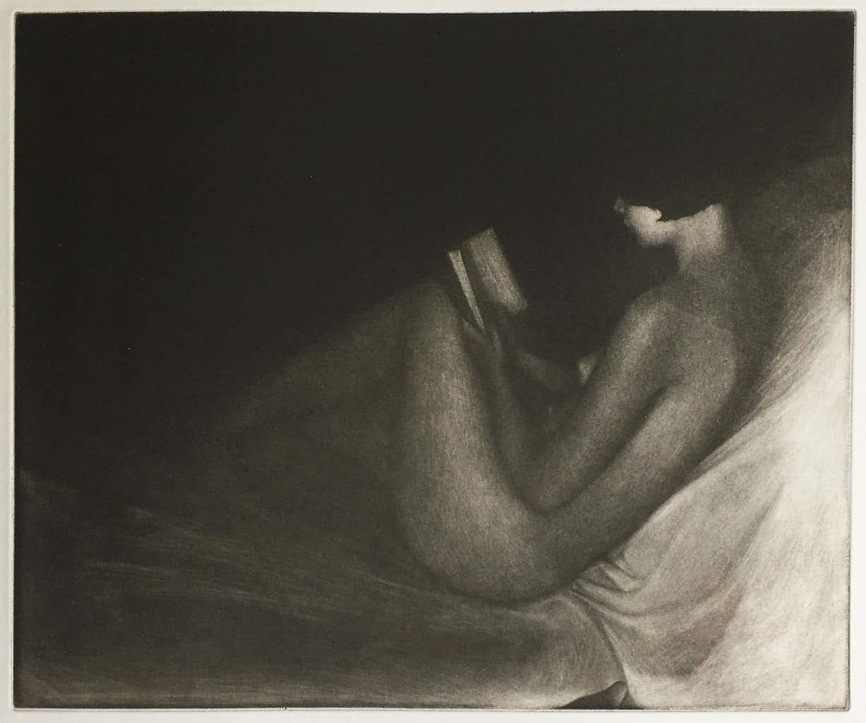 """""""Claire Reading"""" - picture of a female nude model reading, against a black background. Original print mezzotint by painter-printmaker Marina Kim"""