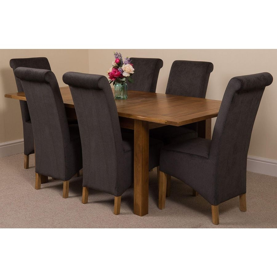 cotswold rustic oak extending dining table with 6 montana dark grey fabric chairs
