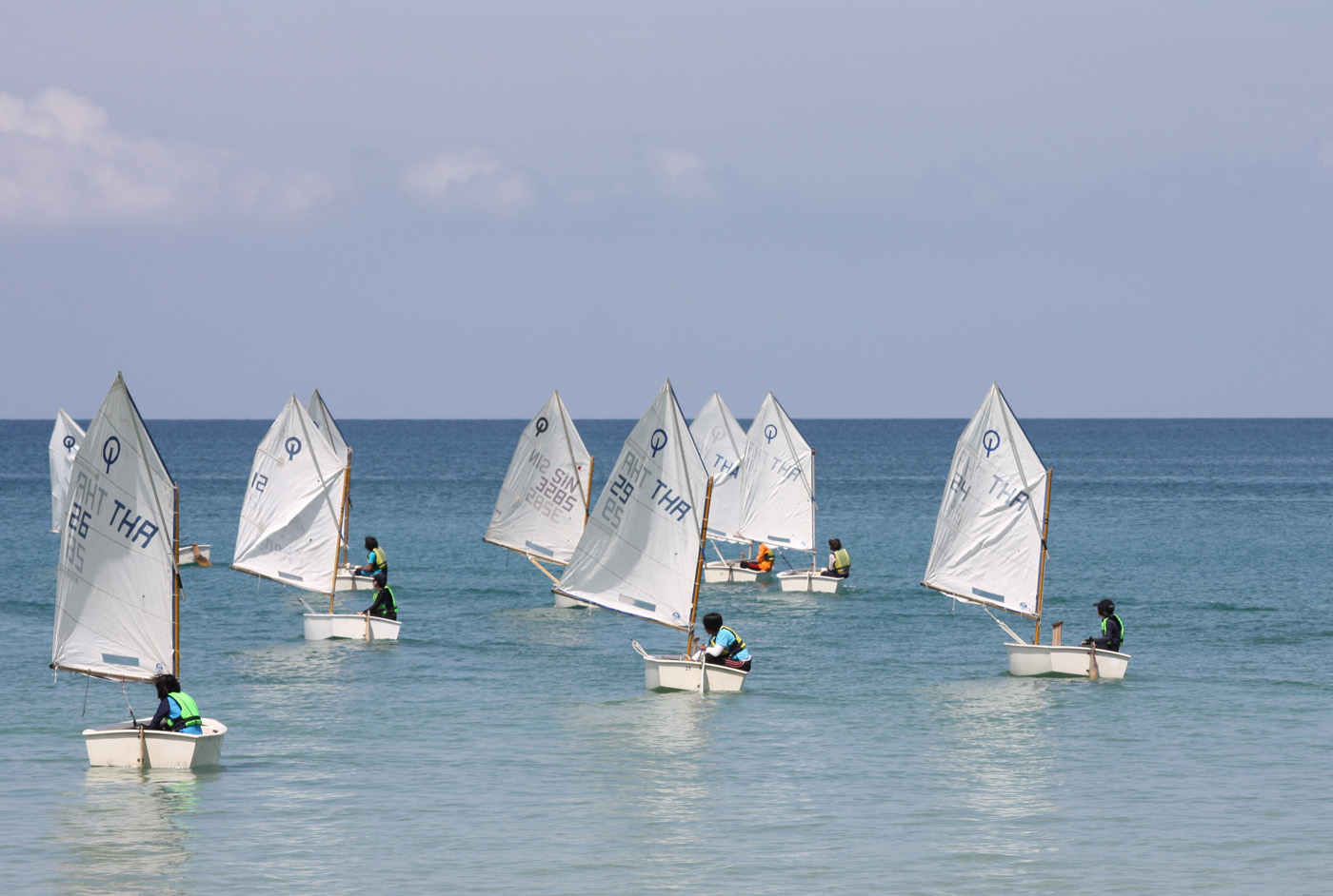 A 16-strong Optimist Class battled it out at Act II of the 2012 Phuket Dinghy Series held off Bang Tao Beach. Photo by MarineScene.asia.