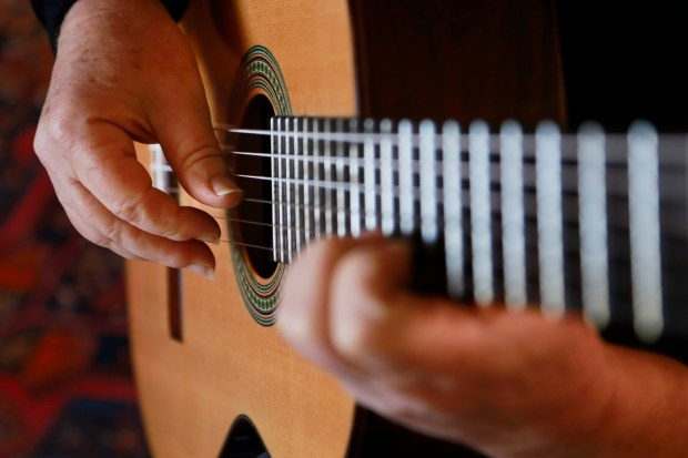 Classical guitar virtuoso plays music from Bach to the