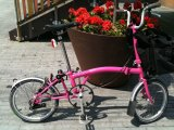 photo of Marion Barral's pink Brompton bike