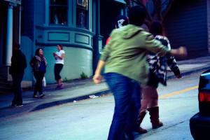 people climbing lombard street