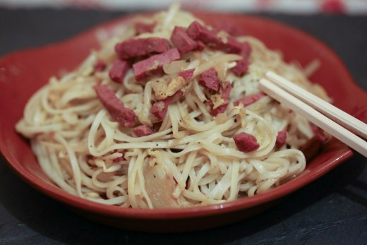 Plate of Spicy Asian sautéed noodles with duck