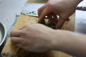 chopping pak choi thinly