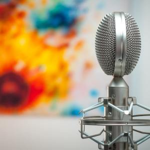 A photograph of a microphone by Michal Czyz on Unsplash