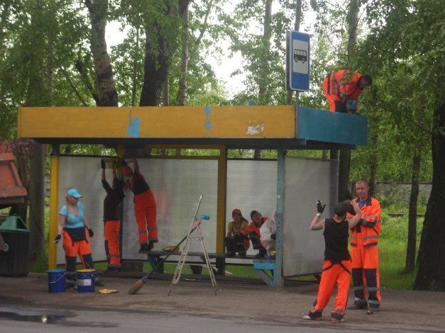 Nine staff, four workers, one bus stop