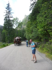 Mark on the trail to Morskie Oko, with a horse carriage headed our way